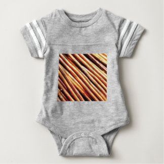 piles of copper pipes baby bodysuit