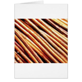 piles of copper pipes card
