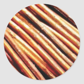 piles of copper pipes classic round sticker