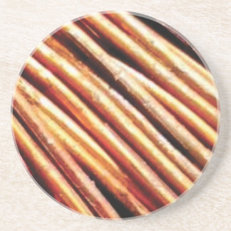 piles of copper pipes coaster
