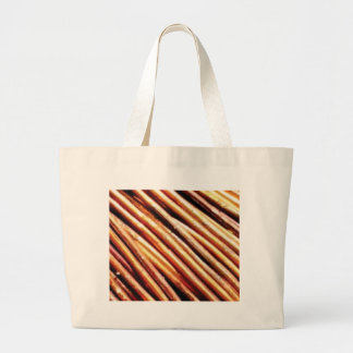 piles of copper pipes large tote bag