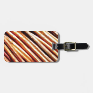 piles of copper pipes luggage tag