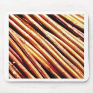 piles of copper pipes mouse pad