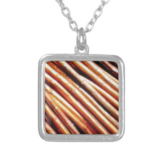 piles of copper pipes silver plated necklace