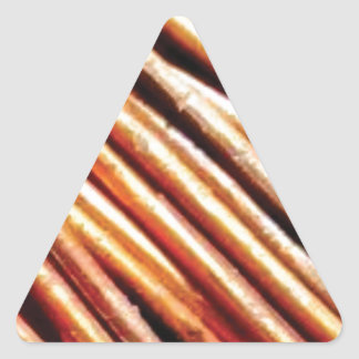 piles of copper pipes triangle sticker