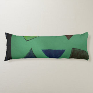 Pillow narrow and long with green and odd shapes.