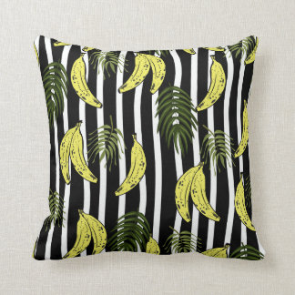 Pillow with banana and palm leaves pattern.