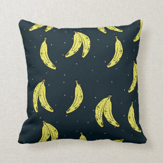 Pillow with banana and sky pattern.