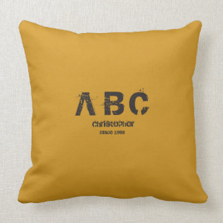 Pillow with central Monogram