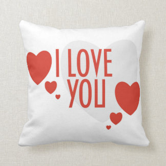 """Pillow with Red Heart Shapes and text """"I love you"""""""