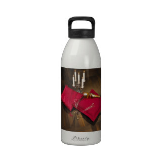Pillows, candlesticks and champagne on dark parque drinking bottle