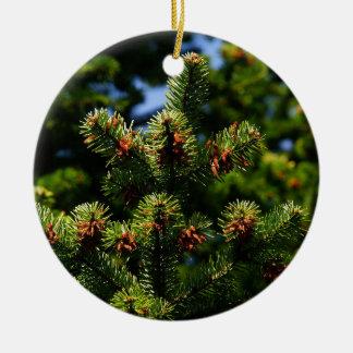 Pine trees round ceramic ornament