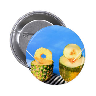 Pineapple and melon fruit with straws at pool 2 inch round button