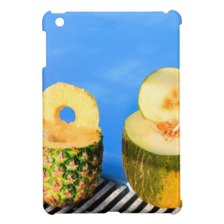 Pineapple and melon fruit with straws at pool iPad mini cases