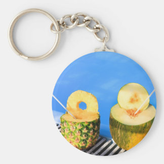 Pineapple and melon fruit with straws at pool keychain
