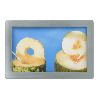 Pineapple and melon fruit with straws at pool rectangular belt buckle