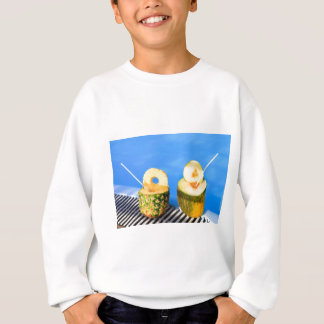 Pineapple and melon fruit with straws at pool sweatshirt