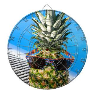 Pineapple wearing sunglasses at swimming pool dartboard