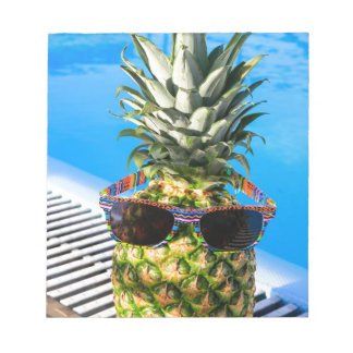 Pineapple wearing sunglasses at swimming pool notepad