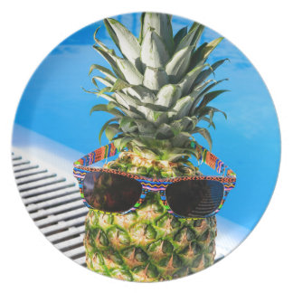 Pineapple wearing sunglasses at swimming pool plate