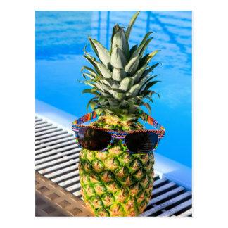 Pineapple wearing sunglasses at swimming pool postcard