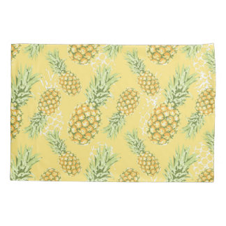 pineapples on soft yellow pillowcase