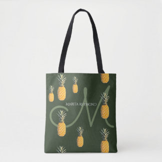 pineapples with name and initial on dark-green tote bag