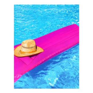 Pink air mattrass with hat in swimming pool letterhead