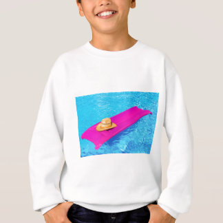 Pink air mattrass with hat in swimming pool sweatshirt