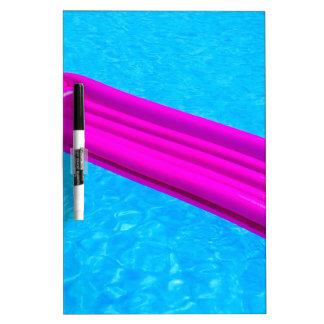 Pink air mattress on water of swimming pool dry erase whiteboard
