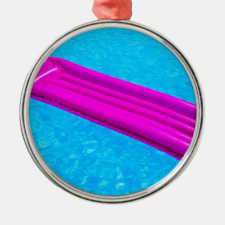 Pink air mattress on water of swimming pool Silver-Colored round ornament