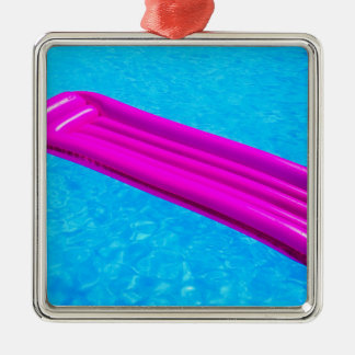Pink air mattress on water of swimming pool Silver-Colored square ornament
