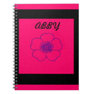 pink and black photo notebook. notebook