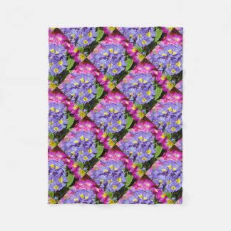 Pink and purple primroses fleece blanket