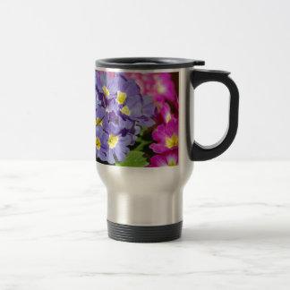 Pink and purple primroses travel mug