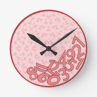 Pink and red, fallen numbers round clock