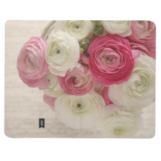 Pink and white ranunculus on script journal