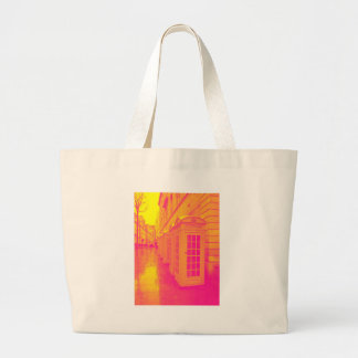Pink and yellow telephone boxes tote bags