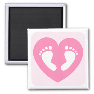 Pink baby girl feet or footprints in heart magnet