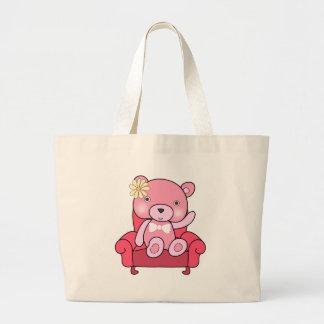 Pink bear on sofa art large tote bag