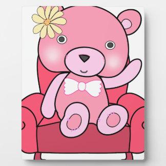Pink bear on sofa art plaque