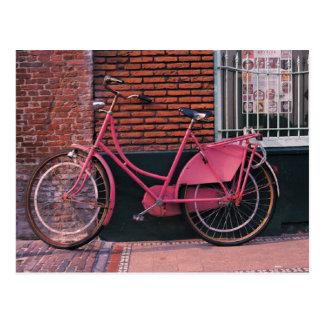 Pink Bike Against Brick Wall Postcard