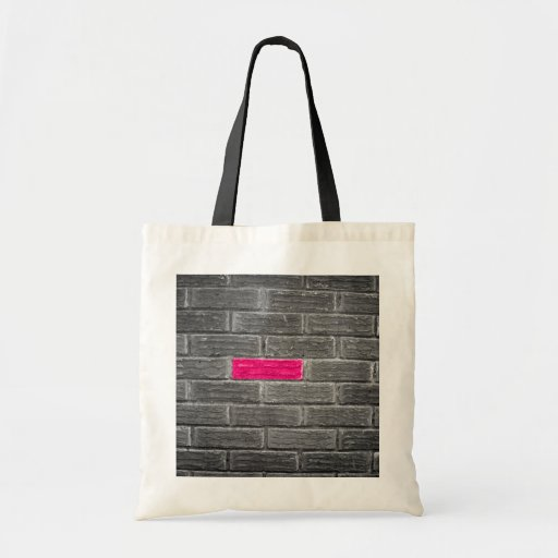Pink Brick In A Black & White Wall Tote Bags