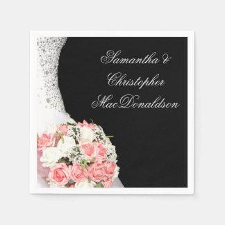 Pink brides wedding roses on black paper napkin