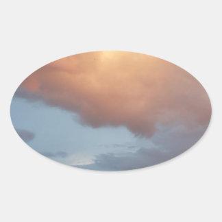 Pink clouds, blue sky oval sticker