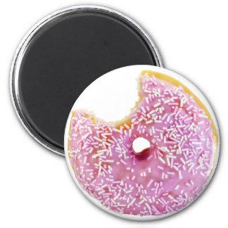 pink doughnut with a missing bite fridge magnet