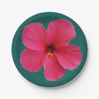 pink flower on dark green paper plate