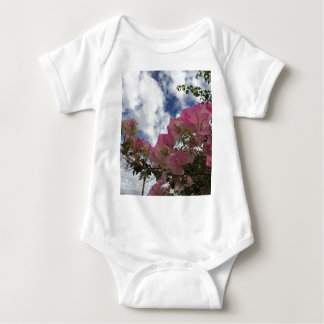 pink flowers against a blue sky baby bodysuit