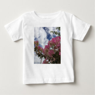 pink flowers against a blue sky baby T-Shirt