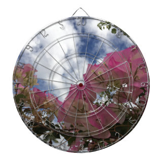 pink flowers against a blue sky dartboard